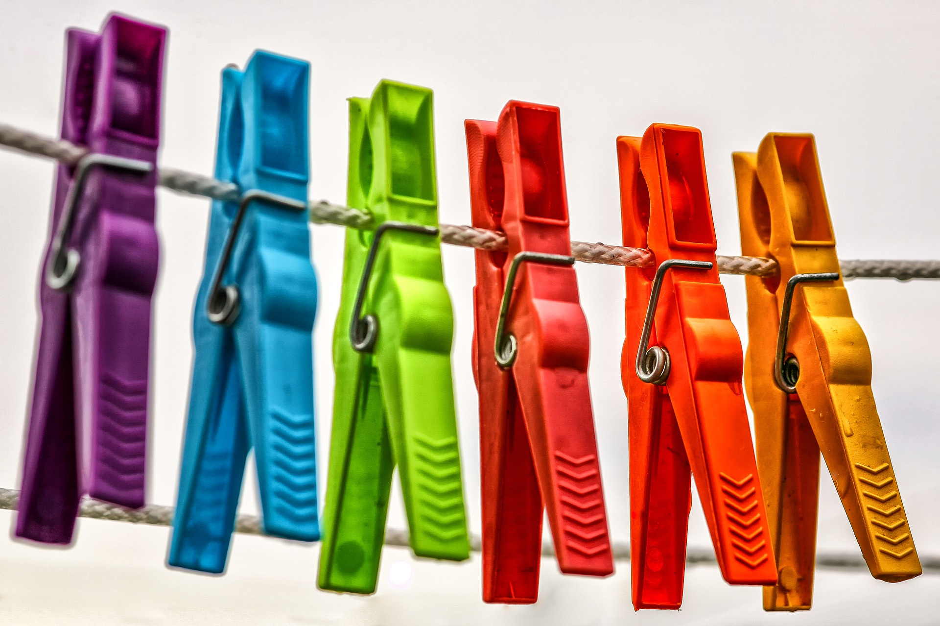multi coloured clothespins on a line